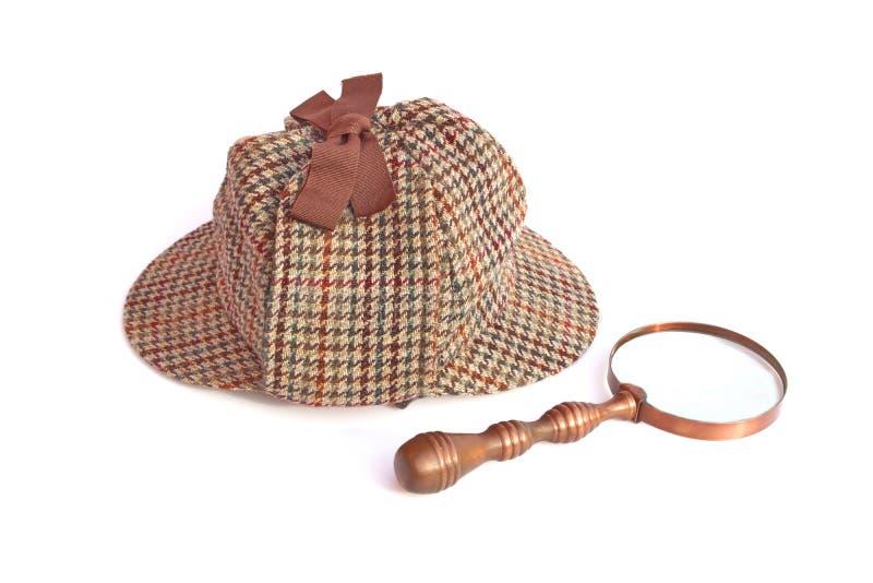 Deerhunter of Sherlock Holmes GLB en uitstekend vergrootglas stock afbeeldingen