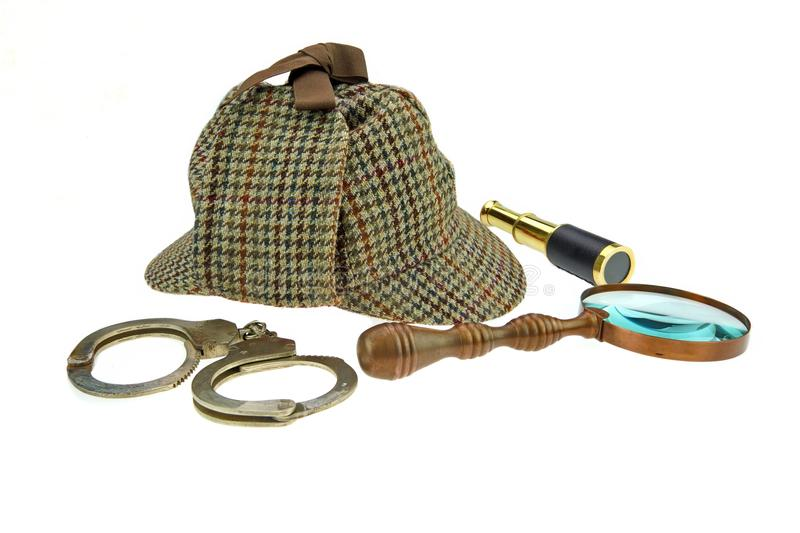 Deerstalker Hat, Magnifer, Handcuffs and Spyglass stock photos