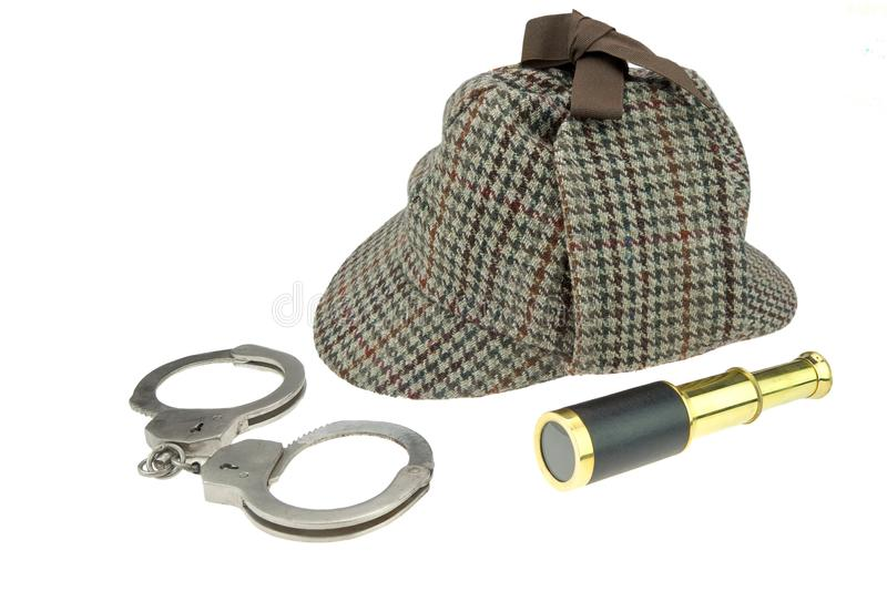 Deerstalker Hat, Real Handcuffs and Retro Spyglass stock photo