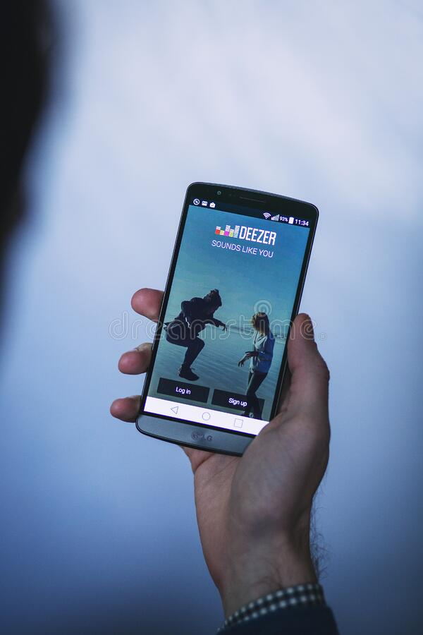 Deezer app on smartphone royalty free stock image