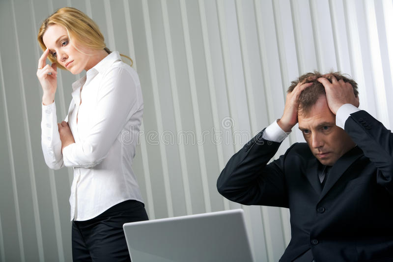 Default. Photo of stressed businessman touching his head with sad woman near by stock photography