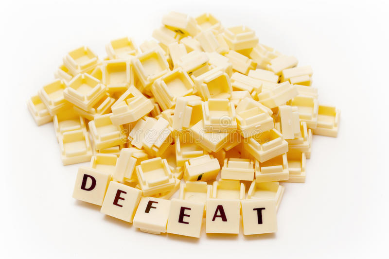 Defeat Text. Text 'Defeat' and a spill of blocks royalty free stock photography