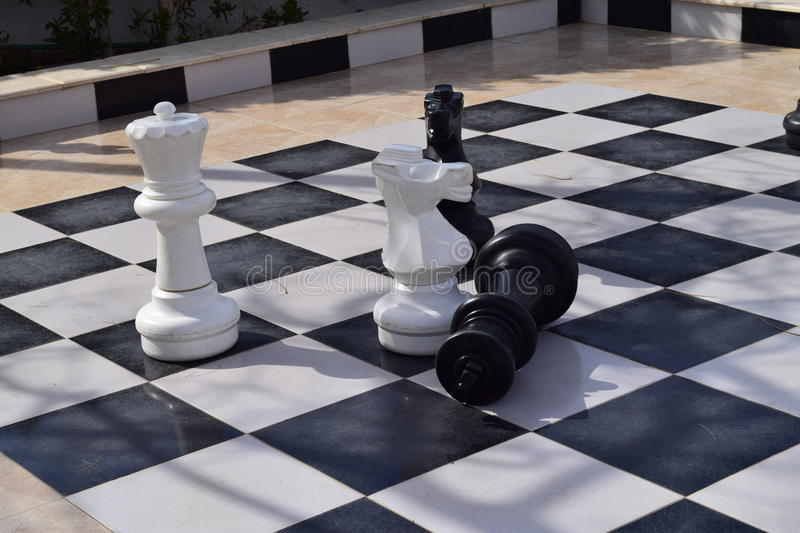 Defeated king. Victory in a game of chess royalty free stock photo