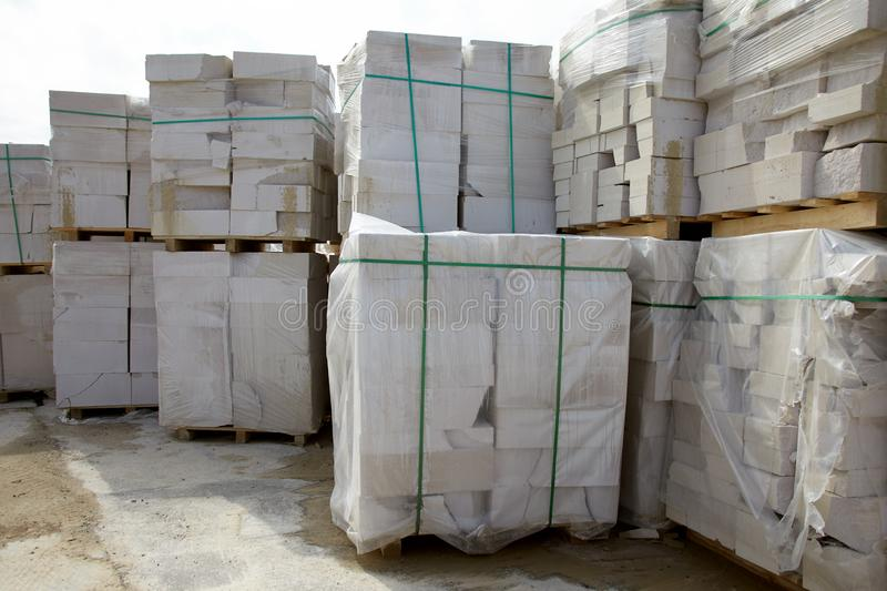 Defective aerated concrete blocks on pallets stored at warehouse.  royalty free stock photo