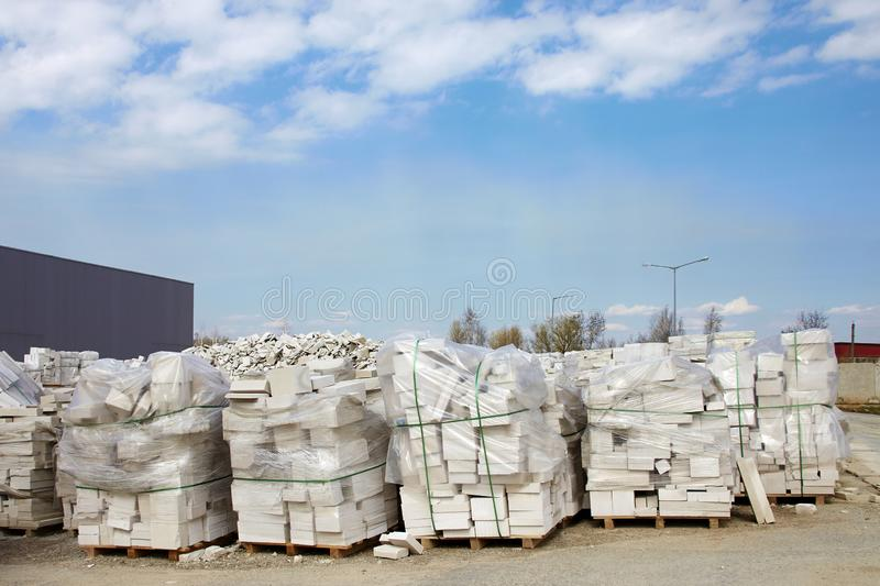 Defective aerated concrete blocks on pallets stored at warehouse.  stock image