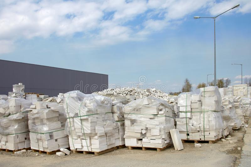 Defective aerated concrete blocks on pallets stored at warehouse.  stock photography