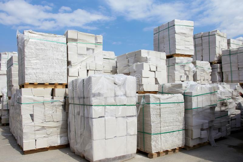 Defective aerated concrete blocks on pallets stored at warehouse.  stock photos