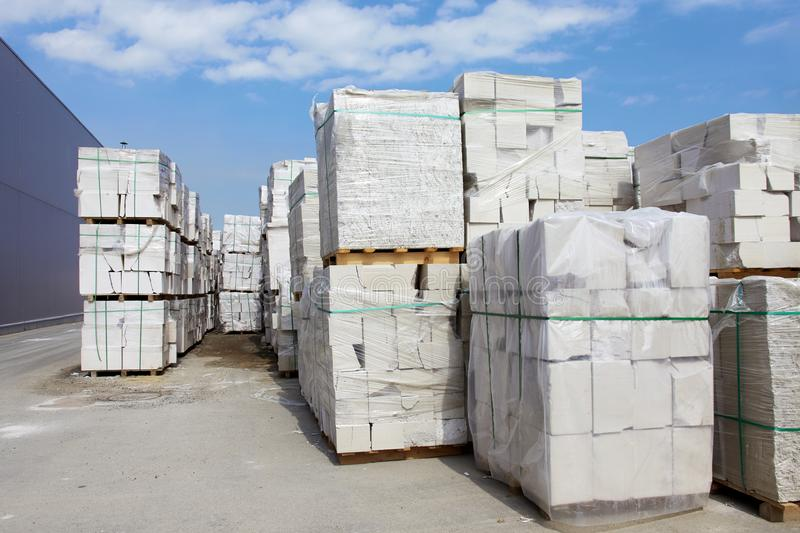 Defective aerated concrete blocks on pallets stored at warehouse.  royalty free stock photos