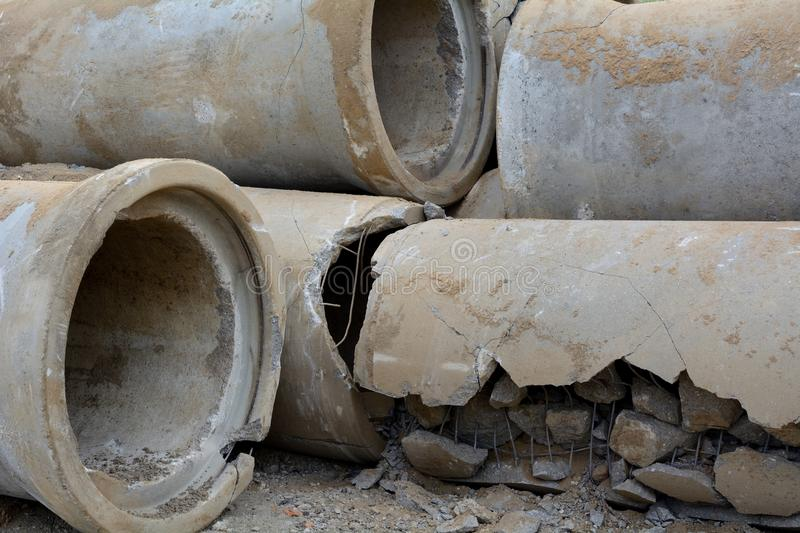 Defective sewer pipes. Destroyed channel concrete pipes stock image