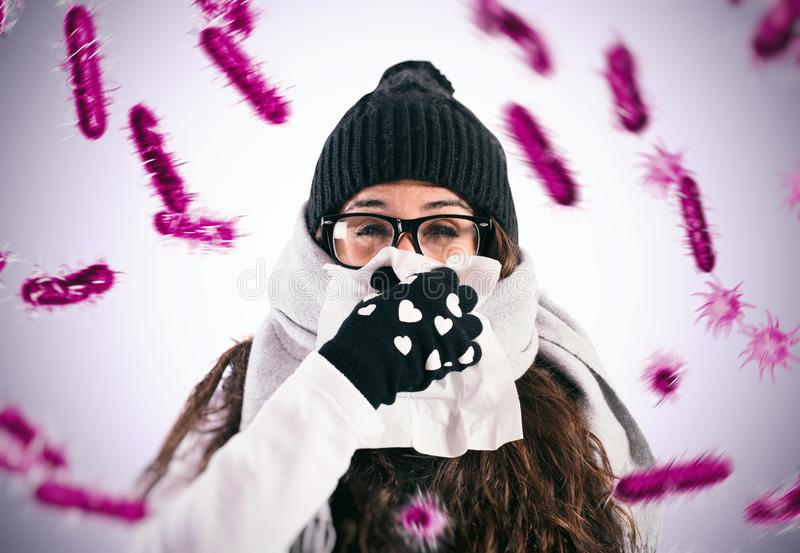 Defend against the flu and cold that are infected by viruses. Girl blows her nose because she got the flu royalty free stock images