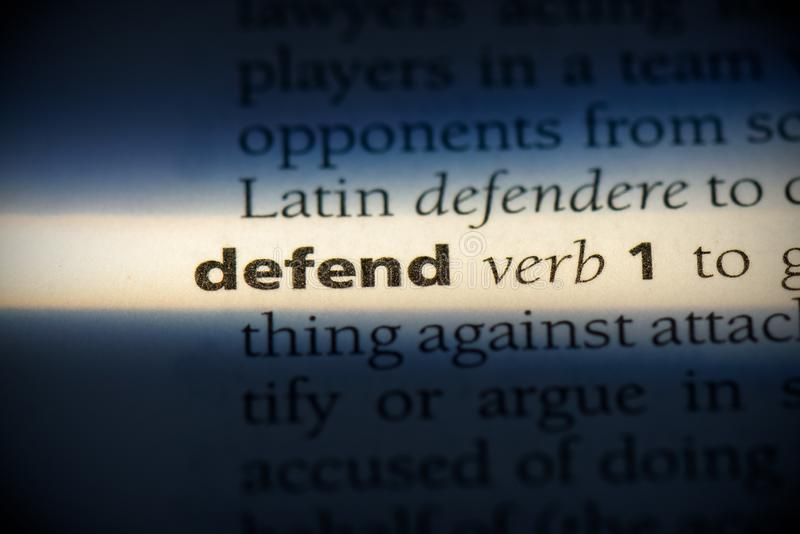 Defend. Word in a dictionary.  concept, definition royalty free stock photography