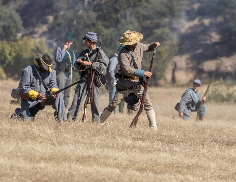 Defending the Hill. Civil War era soldiers in battle at the Dog Island reenactment in Red Bluff, California royalty free stock images