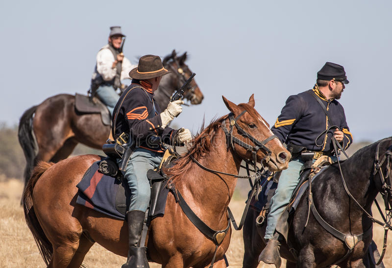 Defending the Hill. Civil War era soldiers in battle at the Hawes Farm reenactment in Red Bluff, California stock images