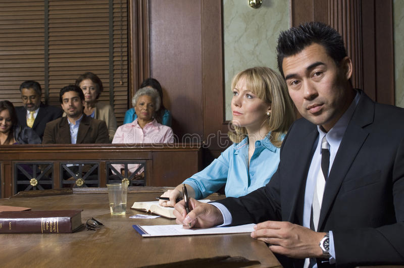 Defense Lawyer With Client In Court stock image