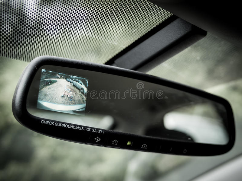 Defensive driving. Using modern technology to check blind spot royalty free stock photo