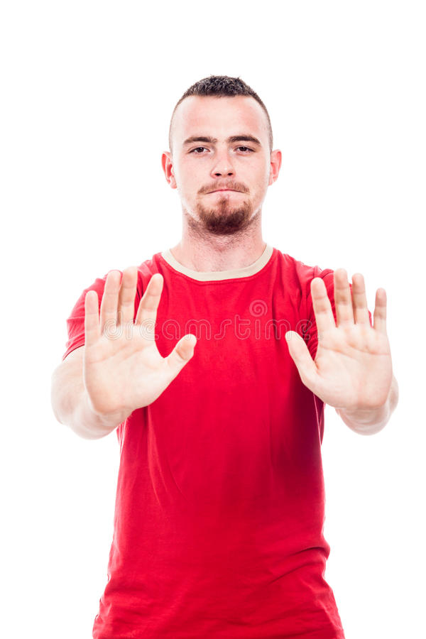 Defensive man. In red t-shirt gesturing stop, isolated on white background stock images