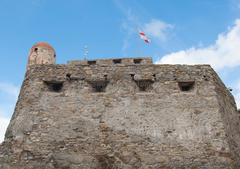 Castle of Dragone in Camogli. Defensive and sight castle on the sea of Camogli with flag royalty free stock photos