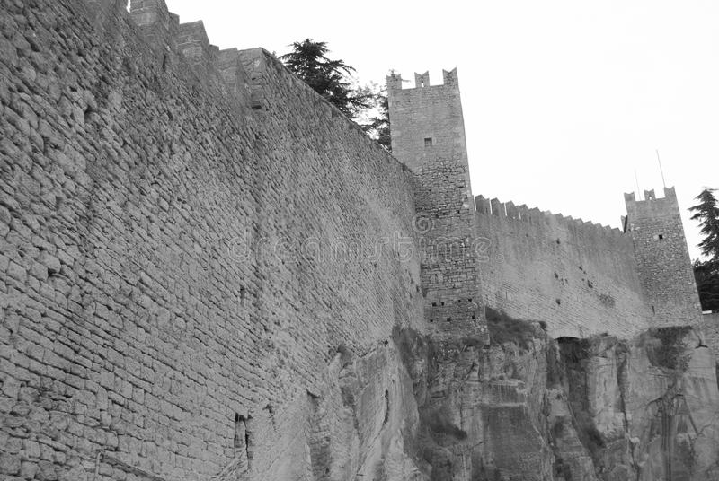 Defensive wall of enclosure in San Marino. Very high perimetric wall surrounds the microstate of San Marino stock photography