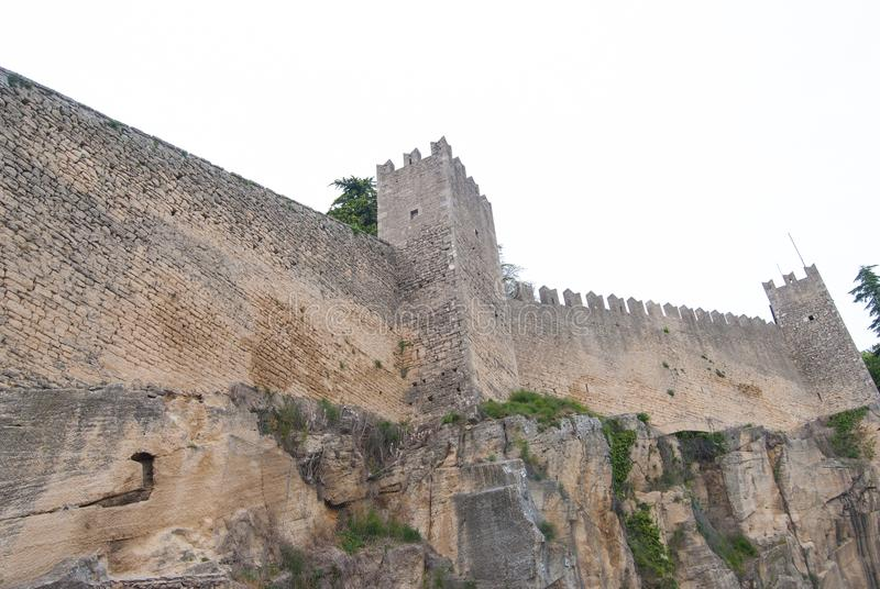 Defensive wall with two towers of enclosure in San Marino. Very high perimetric wall surrounds the microstate of San Marino stock photos