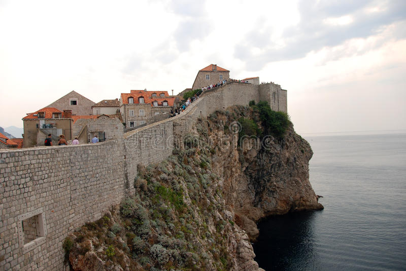 Defensive walls. Mighty defensive walls of the old town of Dubrovnik by the Adriatic sea in Croatia royalty free stock photo
