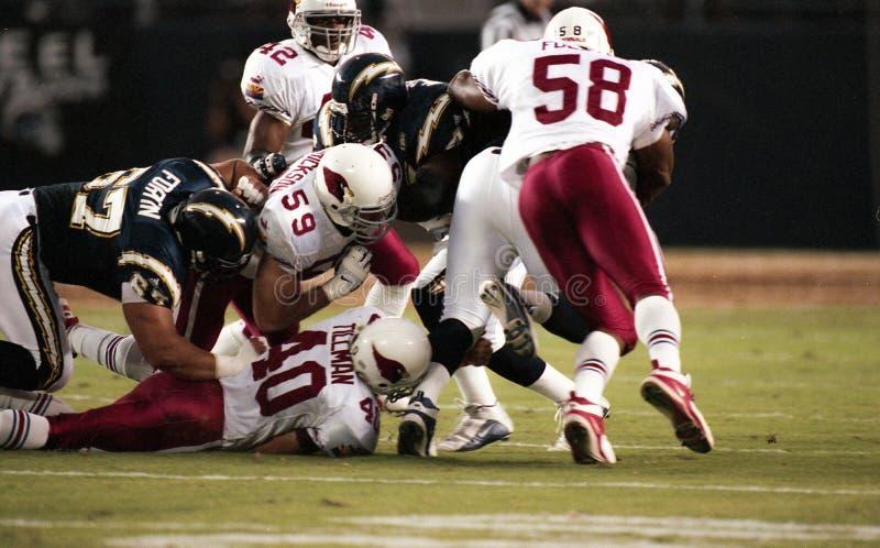 Defesa James Folston, Rob Frederickson e Pat Tillman dos Arizona Cardinals fotografia de stock royalty free