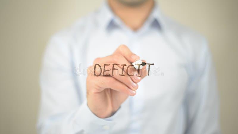 Deficit, escrita do homem na tela transparente fotografia de stock royalty free