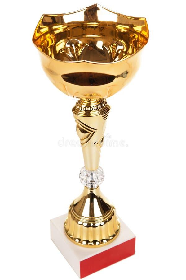 Defienda el trofeo de oro en el fondo blanco, trofeo del oro fotografía de archivo libre de regalías