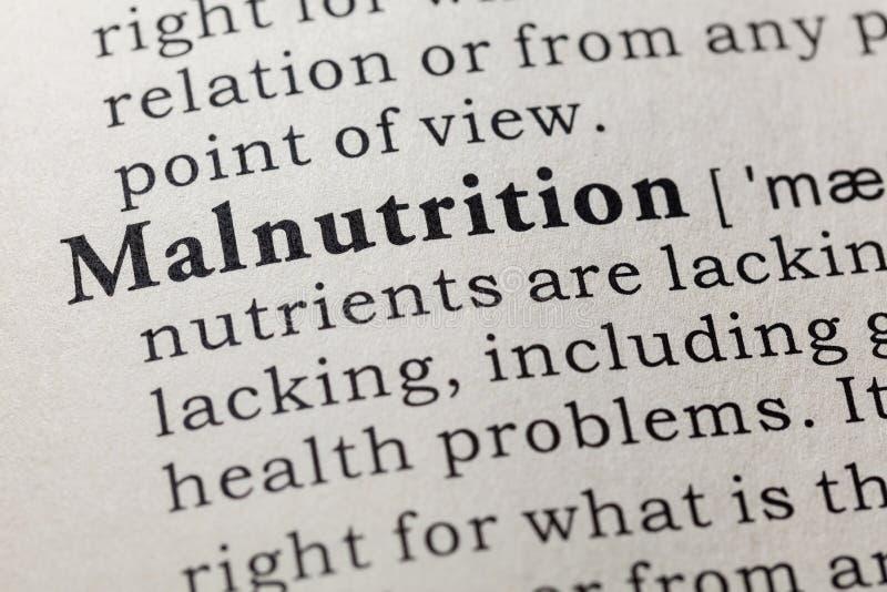 Definição da má nutrição fotos de stock