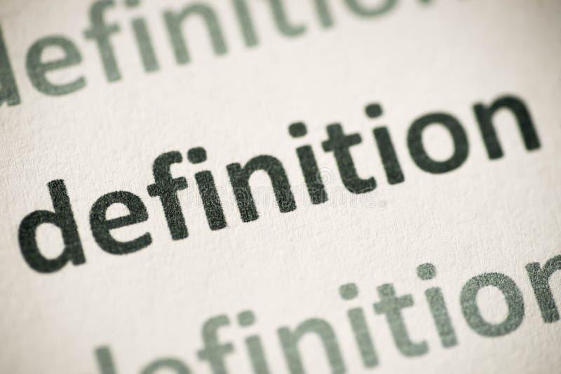 Definição da palavra impressa no macro de papel fotos de stock