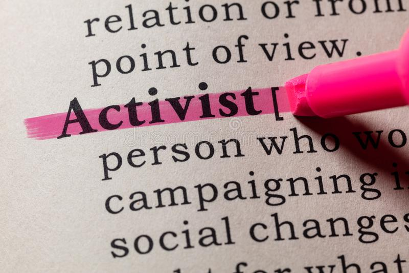 Definición del activista imagenes de archivo