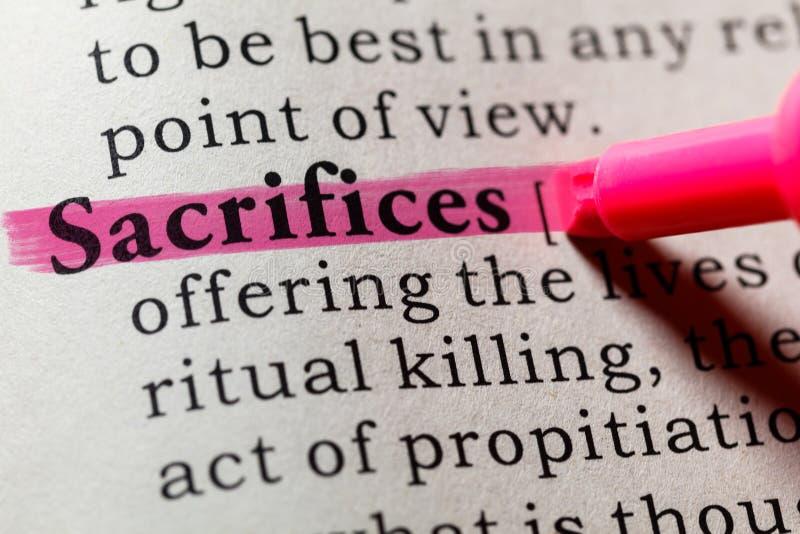 Definition of sacrifices. Fake Dictionary, Dictionary definition of the word sacrifices. including key descriptive words royalty free stock photo