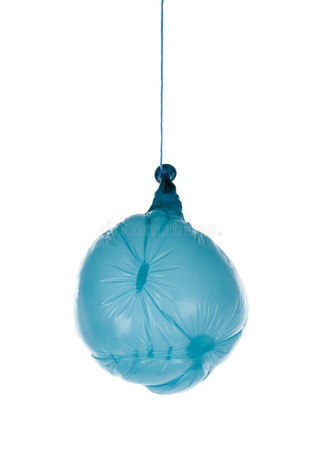 Deflated blue balloon at a rope royalty free stock photos