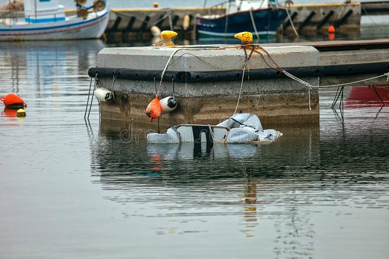 Deflated Dinghy. Laid up at the marina royalty free stock photo