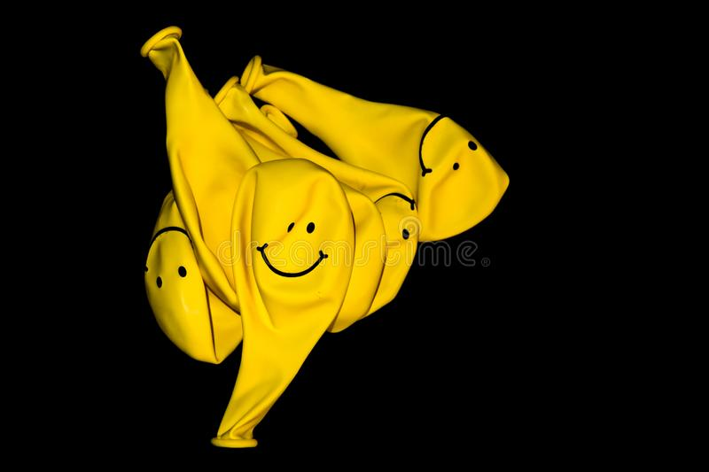 Deflated yellow balloons royalty free stock images