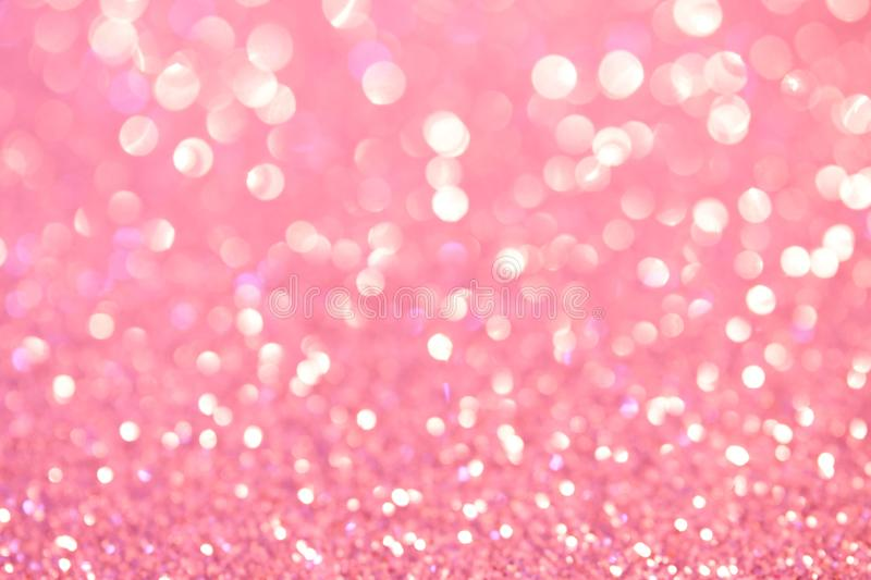 Defocus abstract show. Soft pink holiday lights. Bright background and backdrop. Magic royalty free stock photography