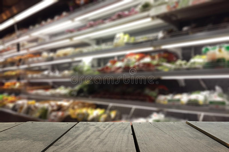 Defocus and blur image of terrace wood and Supermarket. Blur background in Fruits and Vegetables devision for background usage stock image