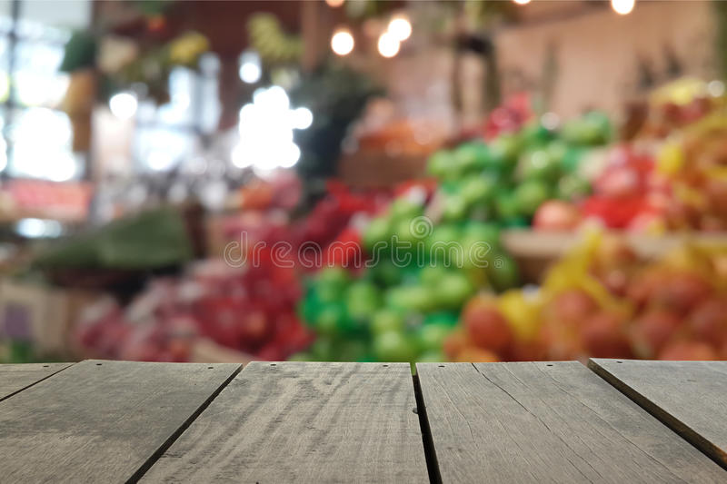 Defocus and blur image of terrace wood and Supermarket. Blur background in Fruits and Vegetables devision for background usage royalty free stock image