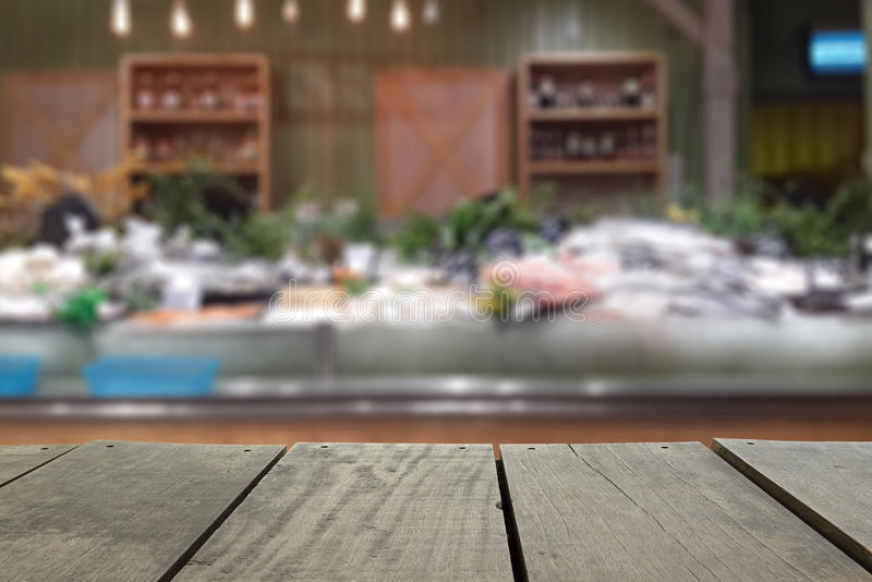 Defocus and blur image of terrace wood and Supermarket. Blur background in seafood devision for background usage stock photo