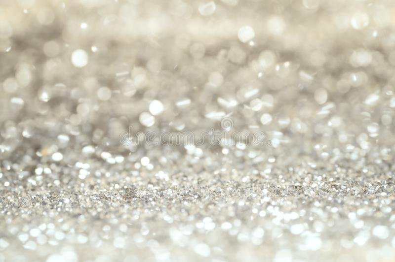 Defocus of glitter vintage lights background. gold, silver and black for Christmas stock photos