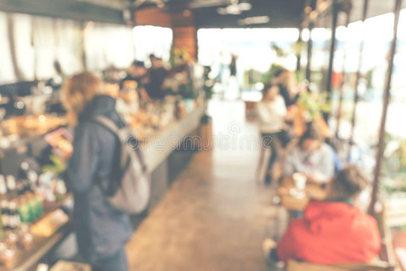 Defocus o restaurante blured con la gente imagen de archivo