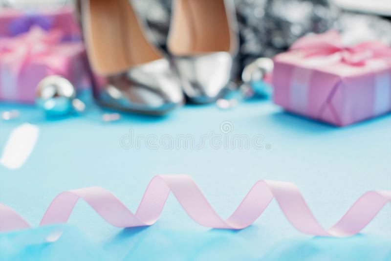 Defocus Set of women& x27;s holiday accessories shoes box gift Christmas balls Christmas poster pastel blurred background stock photography