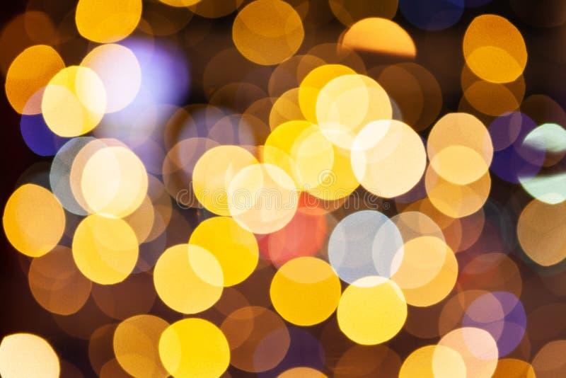defocused红色和黄色闪烁光的背景,特写镜头 库存图片