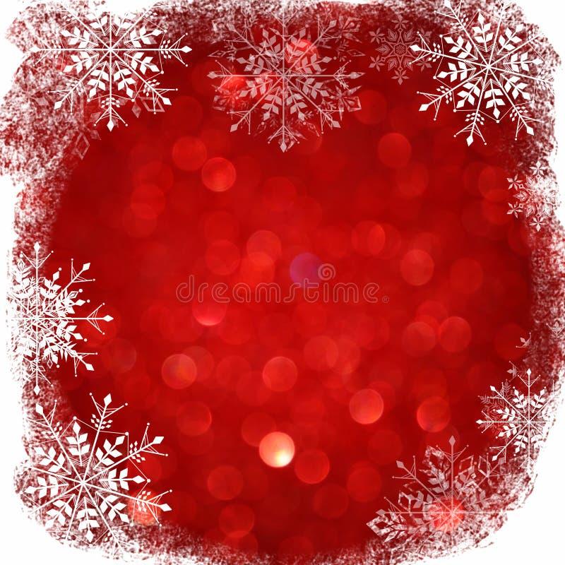 Defocused абстрактная предпосылка красных светов с верхним слоем снежинок стоковые фото