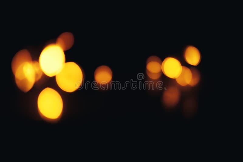 Defocused предпосылка рождества конспекта золота Bokeh немного в угле стоковое изображение