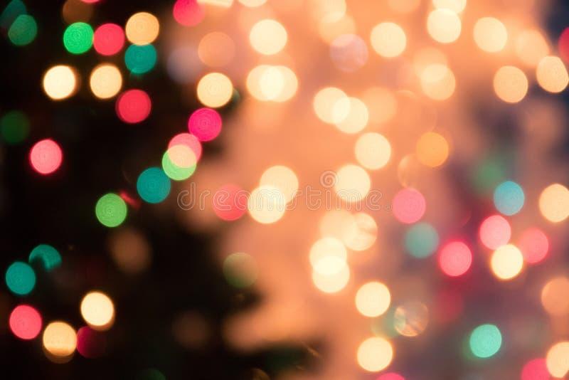 Defocused предпосылка света bokeh на рождество и Новый Год Cele стоковые изображения rf