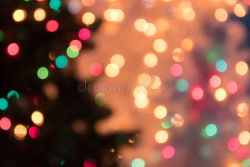 Defocused предпосылка света bokeh на рождество и Новый Год Cele стоковые фотографии rf