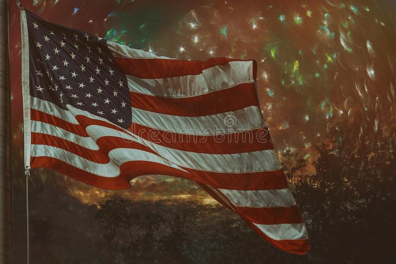 Defocused abstract bokeh background waving american flag. Defocused abstract blue bokeh background waving american flag lights royalty free stock photo