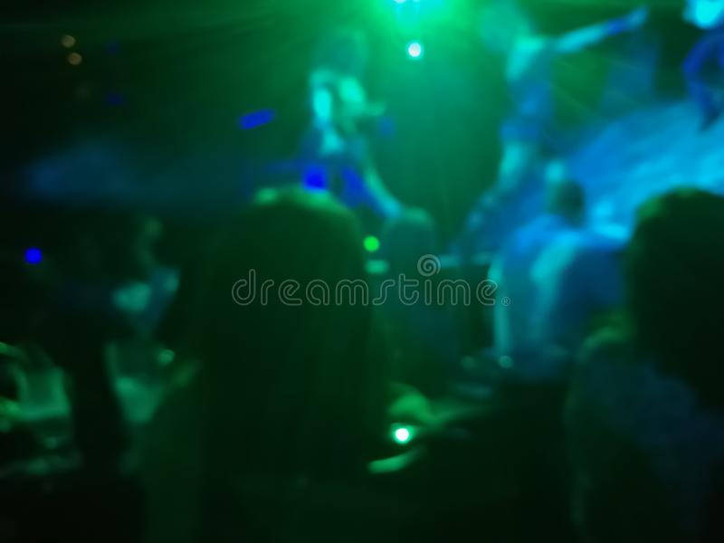 Defocused abstract blurred scene of musical light performance in. A concert on stage with crowd royalty free stock photos