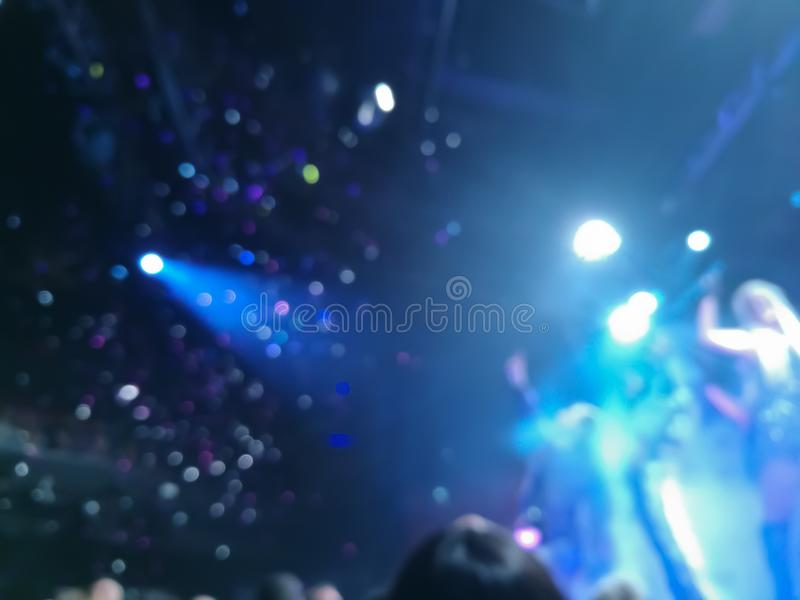 Defocused abstract blurred scene of musical light performance in. A concert on stage with crowd royalty free stock image