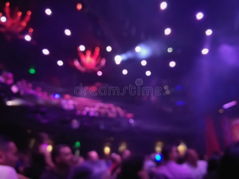 Defocused abstract blurred scene of musical light performance in. A concert on stage with crowd royalty free stock photography